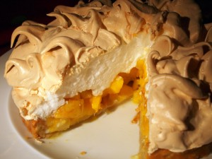 Peach and mango meringue pie