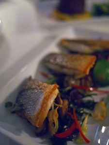 Pan-fried sea bass with garlic crisps, mushrooms, seaweed and truffle oil salad