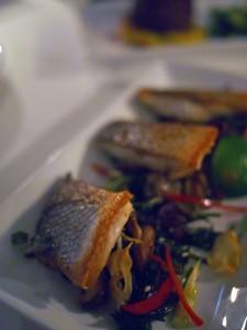 Pan-fried sea bass with garlic crisps, mushrooms, seaweed and truffle oil salad