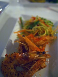 Pepper and coconut crusted prawns with green mango, cashew and coriander salad