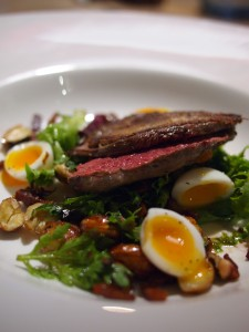 Grouse with a cobnut and bacon salad